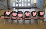 Chairs with pink hearts, San Francisco, California A campaign initiated by parents. These chairs were placed in the lobby of the school. Each chair represents one teacher given a pink slip.