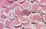 Pink Hearts buttons Worn nationally as a symbol of solidarity between parents, community members, and teachers for preserving education.