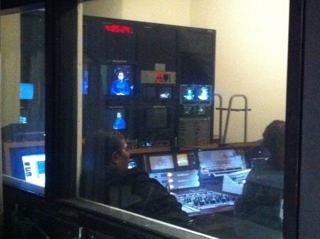 View into the control room from the studio floor