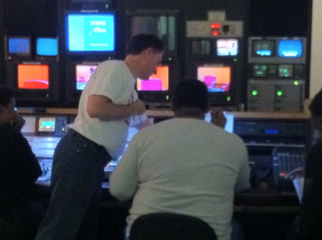 Instructor Eric showing a student how to use the switcher