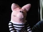 Archibald, our prison pig. Puppet by Noah Ginex, costume by Rebecca Miller.